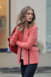 Olivia looked so cute in her coral zip-up jacket on set of a photo shoot in NYC.