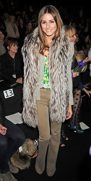 Olivia Palermo teamed her long furry vest with olive flares.