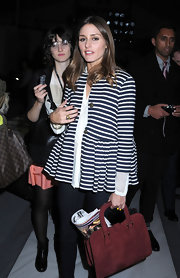 Olivia Palermo accented her nautical style with a wine red suede purse.