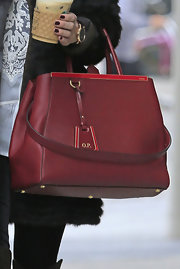 Olivia Palermo gave us bag envy yet again when she toted this red leather tote, initialed key chain and all.