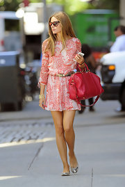 Olivia Palermo kept it minimal and chic with a red and white paisley-print skater dress while out ant about in NYC.