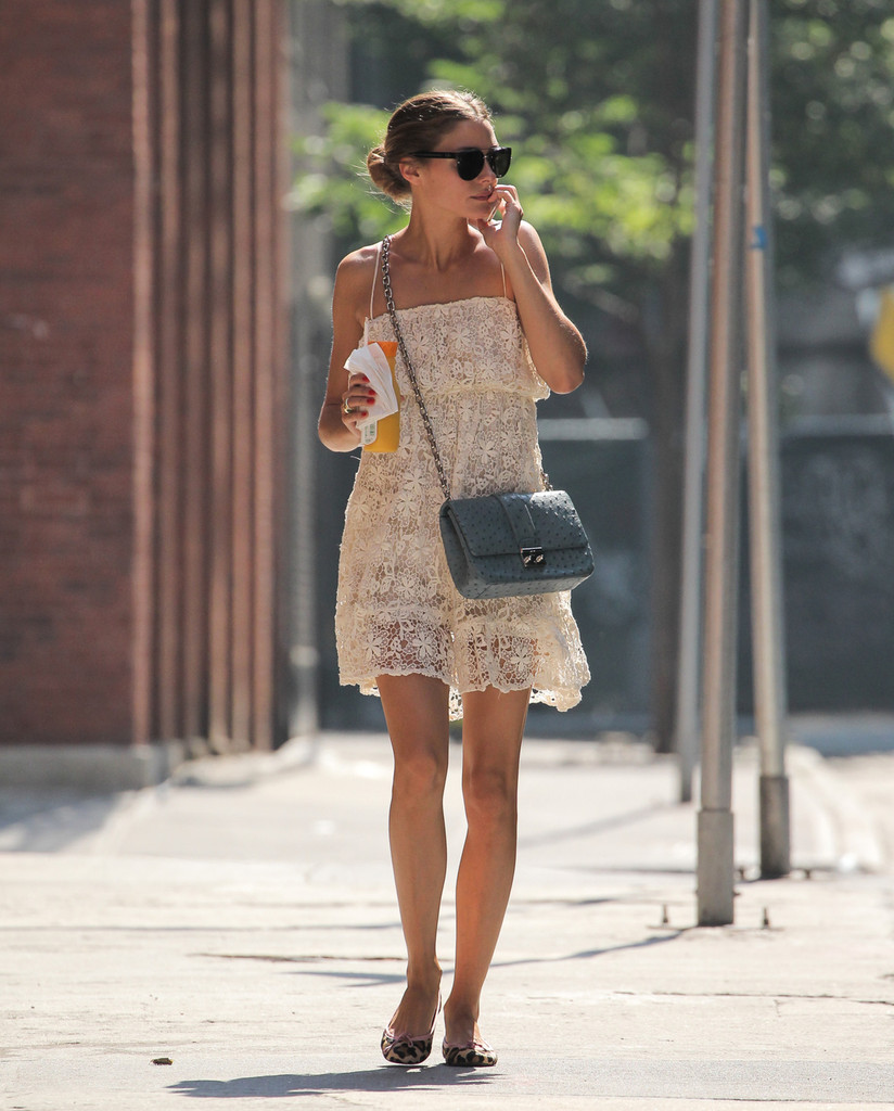 Olivia Palermo takes her dog for a walk in New York City on July 19, 2013.