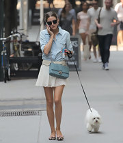 Olivia dressed up a soft chambray top by pairing it with a pleated mini skirt.