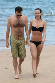 Olivia Wilde stuck to a simple figure-flattering black bandeau while having fun at the beach.