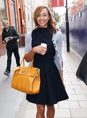 Jessica Ennis made her little black dress a little less formal with a gray cardigan.