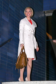 Katherine Heigl added classic elegance to her street style with an off white trenchcoat.