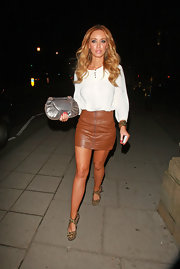 Lauren Pope showed off her bronzed gams in an itsy bitsy tan leather skirt.