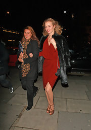 Eva Herzigova paired her draped cocktail frock with retro-inspired platform sandals.