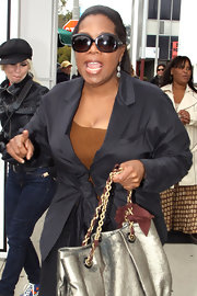 Oprah Winfrey looked super chic at the Oscar luncheon in her fitted black jacket and butterfly sunnies.