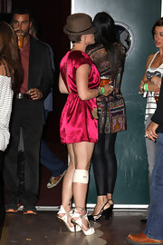 Pink looked chic in a satin mini dress with cool cutout, platform sandals.