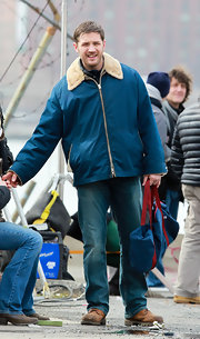 Tom Hardy opted for a casual and sporty look with this blue zip up jacket with fur trim.