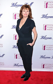 Susan Sarandon surprised us at the Blossom Ball in this navy jumpsuit and patent tasseled flats.