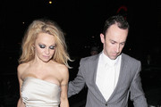 Pamela Anderson looking a little worse for wear as she arrives at her hotel after spending New Years Eve in London.