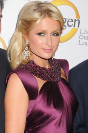 Paris Hilton showed off her elegant side at the Oxygen Media event wearing diamond dangling earrings.