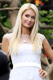 Paris Hilton made an appearance on 'Extra' wearing her hair in signature super-straight style.