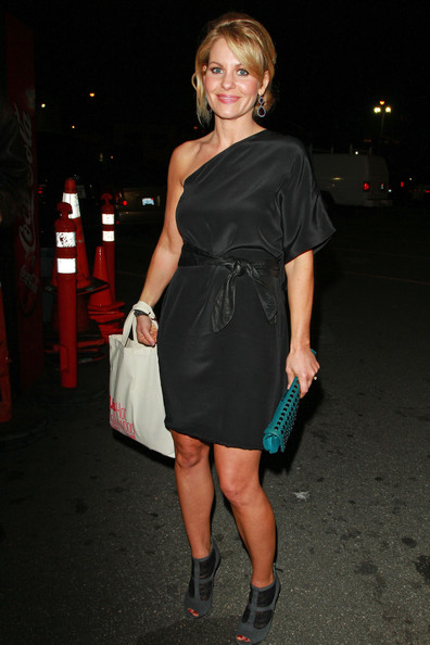 Candace Cameron gave her LBD a fashion forward look with black peep toe ankle boots. The gray suede booties feature black ruching.