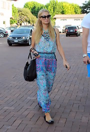 Paris donned a flowing turquoise, halter maxi dress while out with her beau.