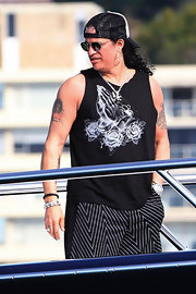 Slash looked relaxed in a print tank top during a Sydney Harbour boat cruise.