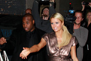 A radiant looking Paris Hilton soaks up all the attention as she happily meets with fans following her appearance on the