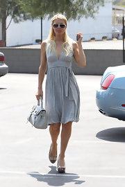 Paris carries a texured white leather handbag while out and about in LA.