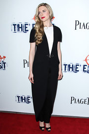 Brit Marling rocked the uber minimal look at the premiere of 'The East' where she wore these black tapered pants and a tailcoat that featured a delicate bow accent.