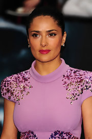 Rather than obstruct her dress' unique neckline, Salma Hayek wisely swept her dark tresses back into a tight, sleek bun.