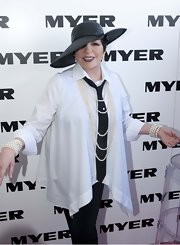 Liza Minnelli arrived at Derby Day wearing a button-down poncho.