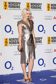 Kimberly Wyatt showed off her cool and contemporary style when she donned this silver V-neck dress that featured an asymmetrical hem.