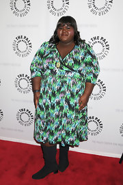 Gabourey wears a 3/4 sleeve wrap print dress.