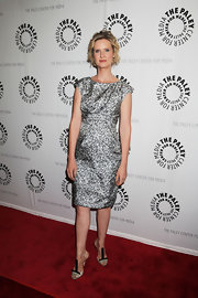 Cynthia Nixon donned modern nude Oscar de la Renta heels. The avant garde footwear features a unique take on the t-strap style, as well as red string holding the shoe together.