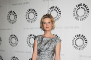Cynthia Nixon poses for photographs before attending a panel discussion for the Showtime comedy series