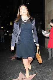 Keely Shaye Smith's black satin blazer and navy cocktail dress were an elegant pairing.