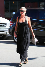 Pink was casually chic in a black maxi dress.