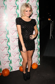 Pixie Lott wore a black cocktail dress with large paillettes for the launch of her album.