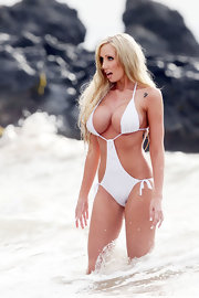 Jenna Bentley poses for the cameras while wearing a skimpy white monokini.