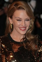 Kylie Minogue attended the premiere of 'Holy Motors' wearing a pair of yellow diamond hoop earrings set in 18-carat yellow gold.