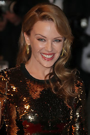 Kylie Minogue took to the red carpet for the 'Holy Motors' premiere wearing her golden locks in long smooth curls.