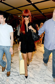 Rihanna sizzled in pointy black patent leather Pigalle stilettos.
