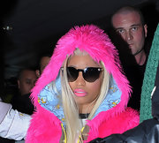 Nicki Minaj kept up her brightly-hued ways while in London by wearing a furry hot pink hooded coat and matching lipstick.