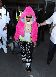 Nicki Minaj arrived in London wearing a pair of puffy black and white snow boots.