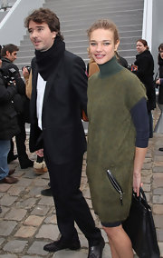 Antoine Arnault added a black scarf to his usual slacks and blazer ensemble at the Louis Vuitton show.