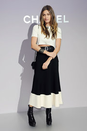 Elisa Sednaoui maintained her black-and-white look with a belted colorblock skirt.