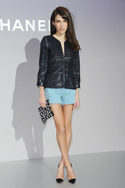 Caroline Sieber dressed up her frayed shorts with a metallic black jacket.