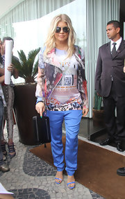 What do you do when you have lots of patterns on top? You add more color, at least according to Fergie who paired a patterned top and jacket with these vibrant periwinkle pants.