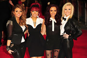 Jesy Nelson looked mod in a black cropped jacket with sheer sleeves and metallic fringe on the shoulders.