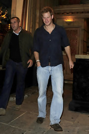 Prince Harry wore light faded jeans with his button-down while out for a night in London.
