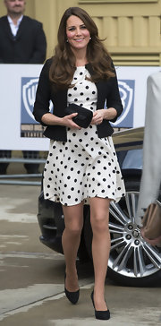 Kate Middleton chose a fitted black jacket to pair over her polka dotted frock.