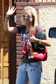 Chelsie Hightower leaves rehearsal for Dancing with the Stars while wearing a white pair of wayfarer sunglasses.  Cool...