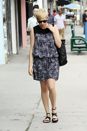 Michelle Williams opted for a fun print dress for her daytime look.