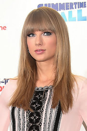 Taylor Swift channeled Cleopatra with her long straight cut and blunt bangs at the Capital FM Summertime Ball.